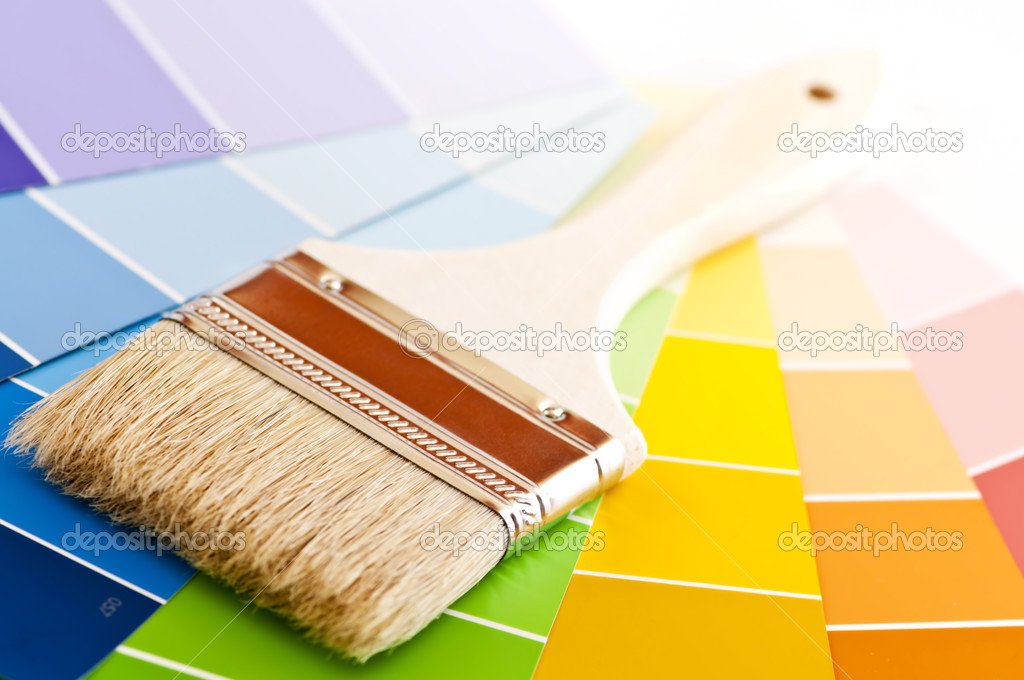 Clean paintbrush on rainbow of color card samples — Stock Photo #4494372