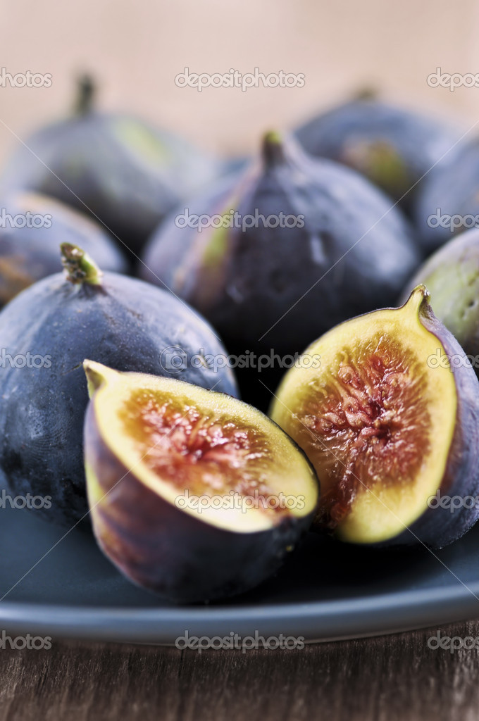 Closeup view of figs sliced in half on a blue plate  Stock Photo #4495421