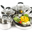 Stainless steel pots and pans with vegetables - Foto Stock