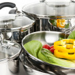 Stainless steel pots and pans with vegetables — Stock Photo #4518485