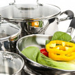 Stainless steel pots and pans with vegetables — 图库照片