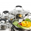 Stainless steel pots and pans with vegetables — Stock Photo #4518496