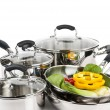 Stainless steel pots and pans with vegetables — Stock Photo #4518497