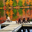 Wooden dock on autumn lake — Stock fotografie #4518768
