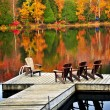 Wooden dock on autumn lake — Stock fotografie