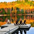 图库照片: Wooden dock on autumn lake