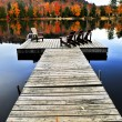 Wooden dock on autumn lake — 图库照片
