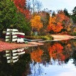 Fall forest reflections with canoes — Stock Photo