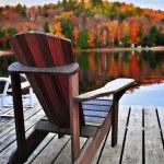 Wooden dock on autumn lake — Stock Photo