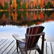 Wooden dock on autumn lake — Foto de Stock
