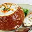 Soup in bread bowl — Stock Photo