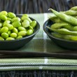 Soy beans in bowls — Stock Photo