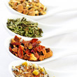 Assorted herbal wellness dry tea in spoons — Stock Photo #4519850