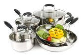 Inox panelas e frigideiras com legumes — Foto Stock