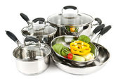 Stainless steel pots and pans with vegetables — Stok fotoğraf