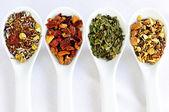 Assorted herbal wellness dry tea in spoons — Stock Photo