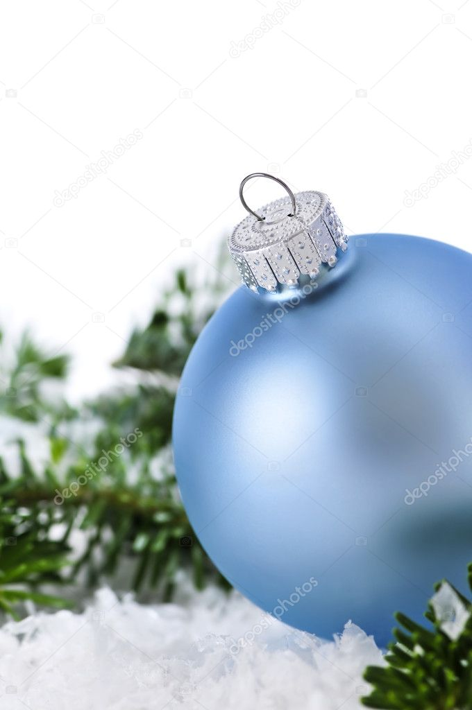 Blue Christmas decoration in snow with pine branches — Stock Photo #4518300