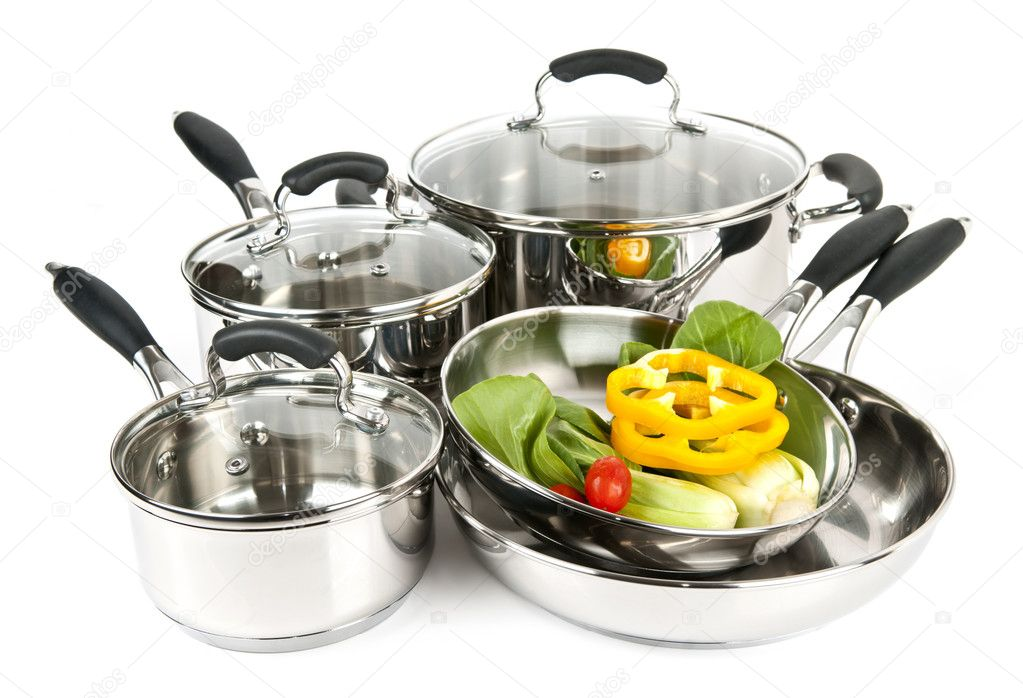 Stainless steel pots and pans isolated on white background with vegetables  Stock Photo #4518482