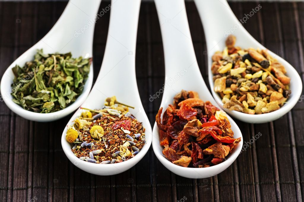 Herbal wellness dried tea in four spoons — Stock Photo #4519848