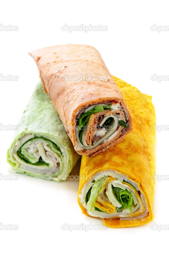 Three isolated multicolored tortilla wraps with meat and vegetables — Photo #4519901