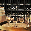 Wine glasses and barrels — Stock Photo