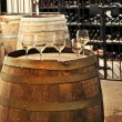 Wine glasses and barrels — Stock Photo #4520274