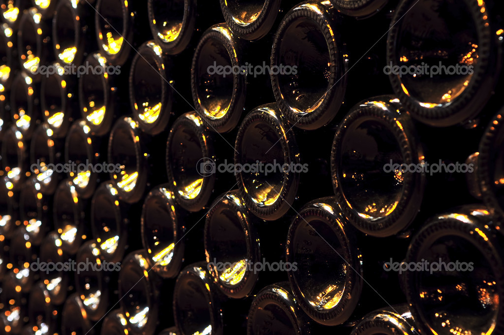 Large stack of wine bottle bottoms in winery — Stock Photo #4520214
