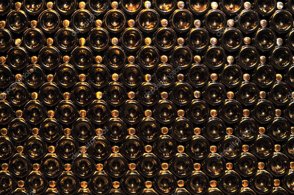 Large stack of wine bottle bottoms in winery — Stock Photo #4520217