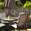 Patio furniture on a deck - Stock Photo