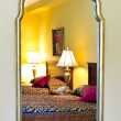 Bedroom interior reflected in mirror — Stock Photo