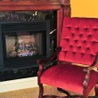 Fireplace and red chair - Stock Photo