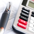 Stock Photo: Tax calculator and pen