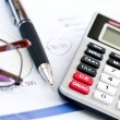 Tax calculator pen and glasses - 