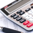 Royalty-Free Stock Photo: Tax calculator and pen