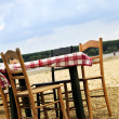 Dining table in a beach - ストック写真
