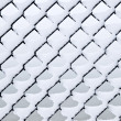 Link fence under snow - Stock Photo