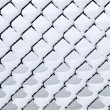 Link fence under snow — Stock Photo