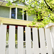 Front yard with white fence — Stock Photo