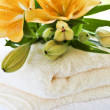 Stack of towels with flowers — Stock Photo
