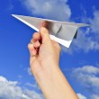 Hand holding paper airplane — Stock Photo