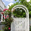 Stock Photo: White arbor in a garden