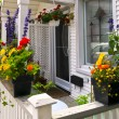 House porch with flower boxes - Stock Photo