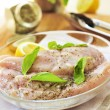 Raw chicken breasts marinating - Stock Photo