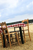 Dining table in a beach — Stock Photo