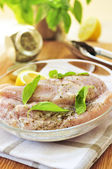 Raw chicken breasts marinating — Stock Photo