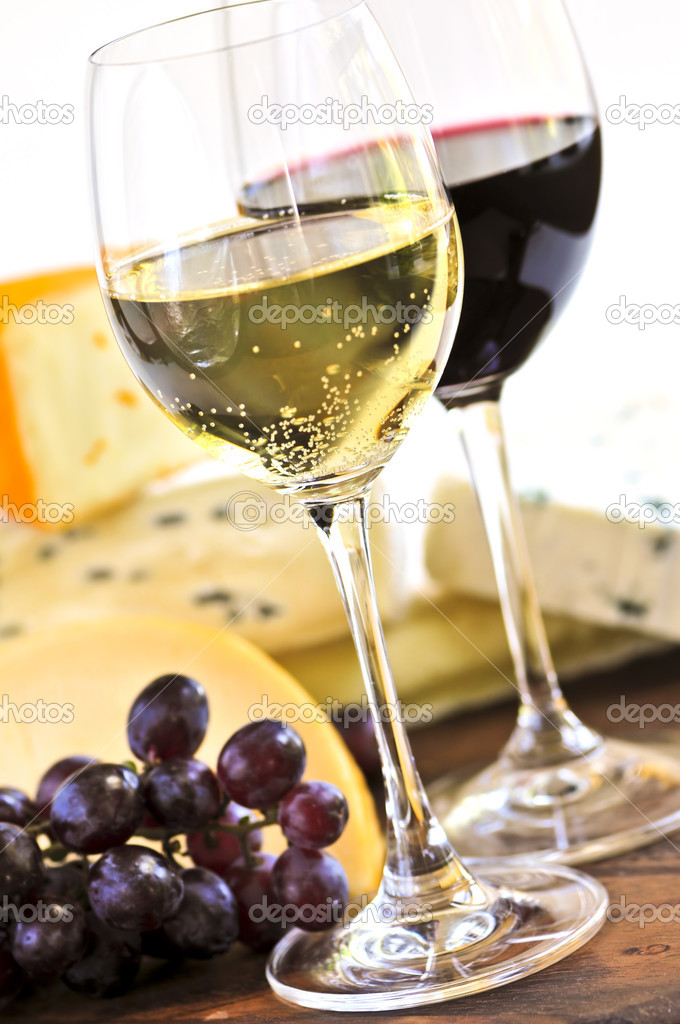 Wineglasses with red and white wine and assorted cheeses — Stock Photo #4566566