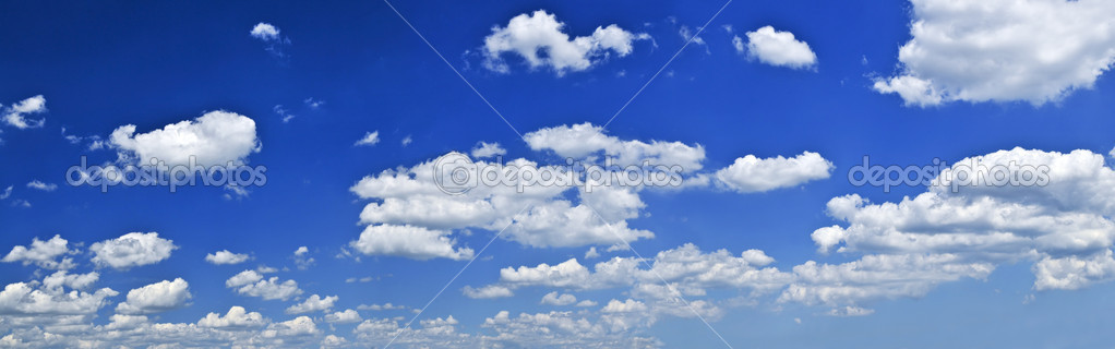 Panoramic background of blue sky with white cumulus clouds — Stock Photo #4569470