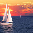 Stock Photo: Sailboats at sunset