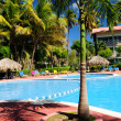 Swimming pool hotel at tropical resort - Stock Photo