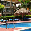 Stock Photo: Swimming pool hotel at tropical resort